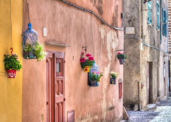 weird flower pots hanging on the wall in Alghero old town